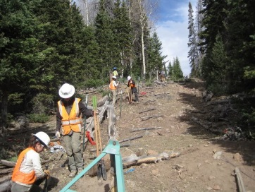 Photo of a crew constructing a new range fence.