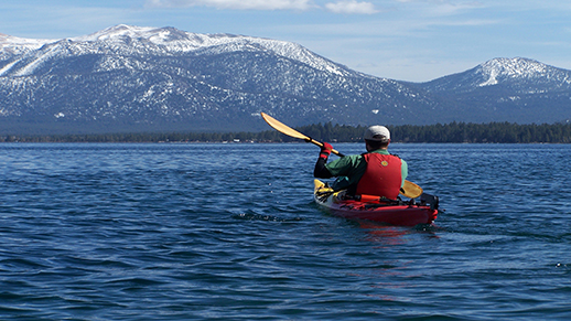 Kayaker paddles on Lake Tahoe.