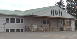 Small photo of the front entrance to the Eureka Ranger Station; a gray building with an FS shield
