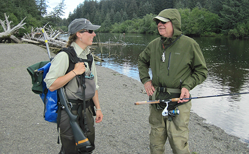 Lisa Byers stops to talk to an angler on the Situk River