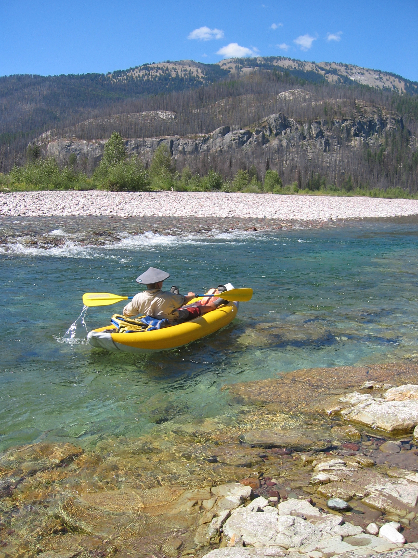 A kayaker floats on the South Fork of the Flathead River