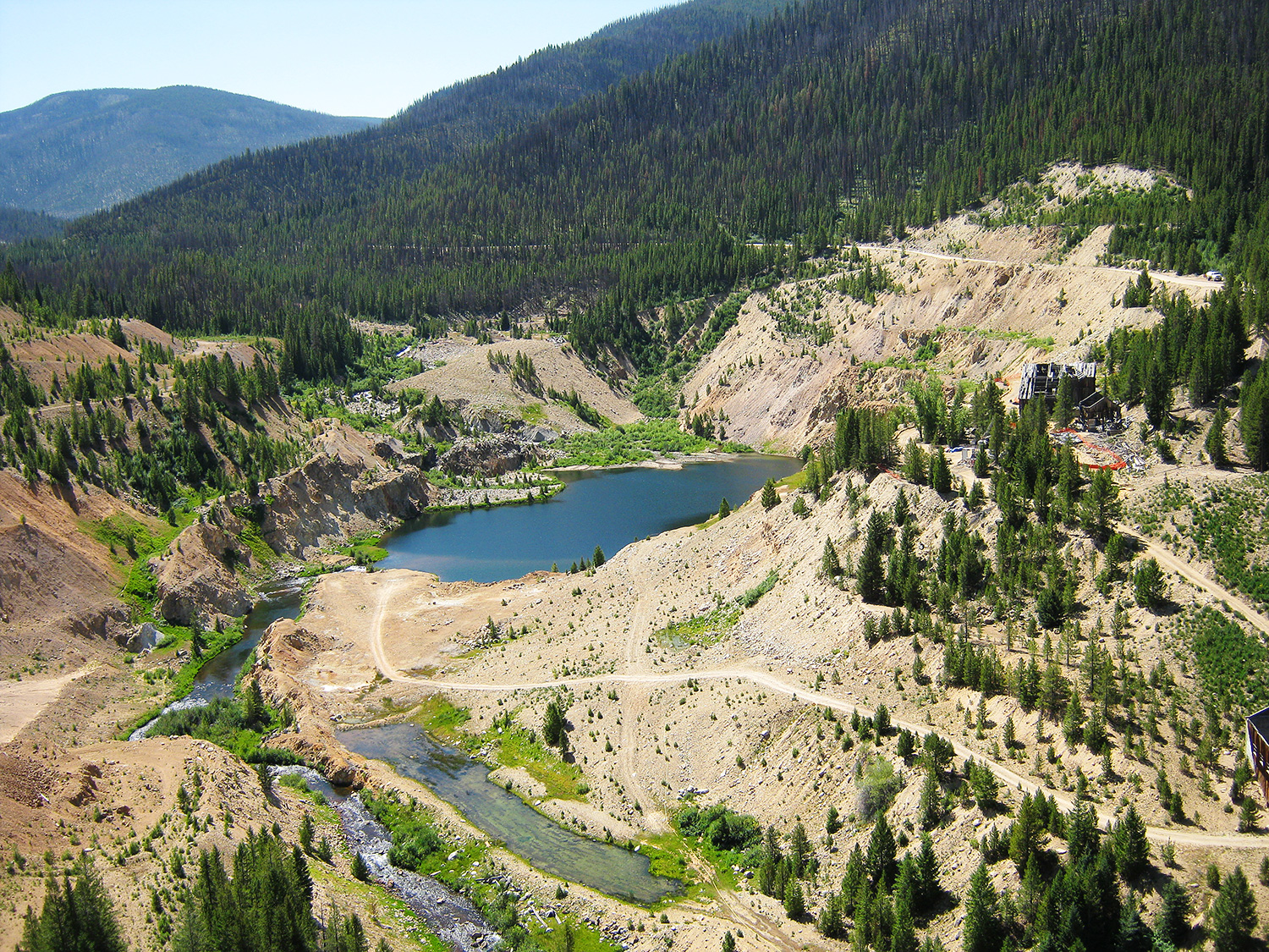 Photo is a wide shot showing the mining district and specifically the Yellowpine pit.