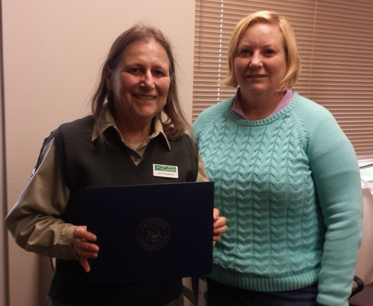 Laura Woodworth (L) proudly displays her Congressional Certificate of Service that was presented by