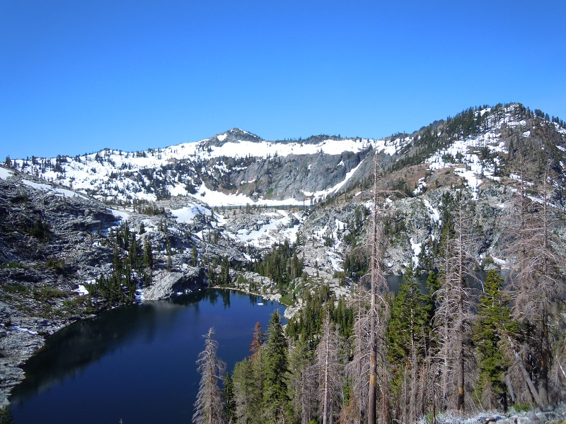 This photograph shows a lake within granite peaks typical in the Trinity Alps Wilderness Area.