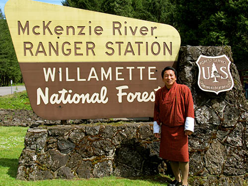 2017 International Visiting Wildlife Biologist from Bhutan in front of the Forest sign