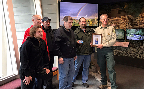 Family of Sharron Lobaugh receive commemorative gift from John Neary, MGVC Director
