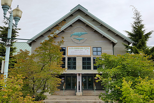 Front entrance of Southeast Alaska Discovery Center with trees on either side