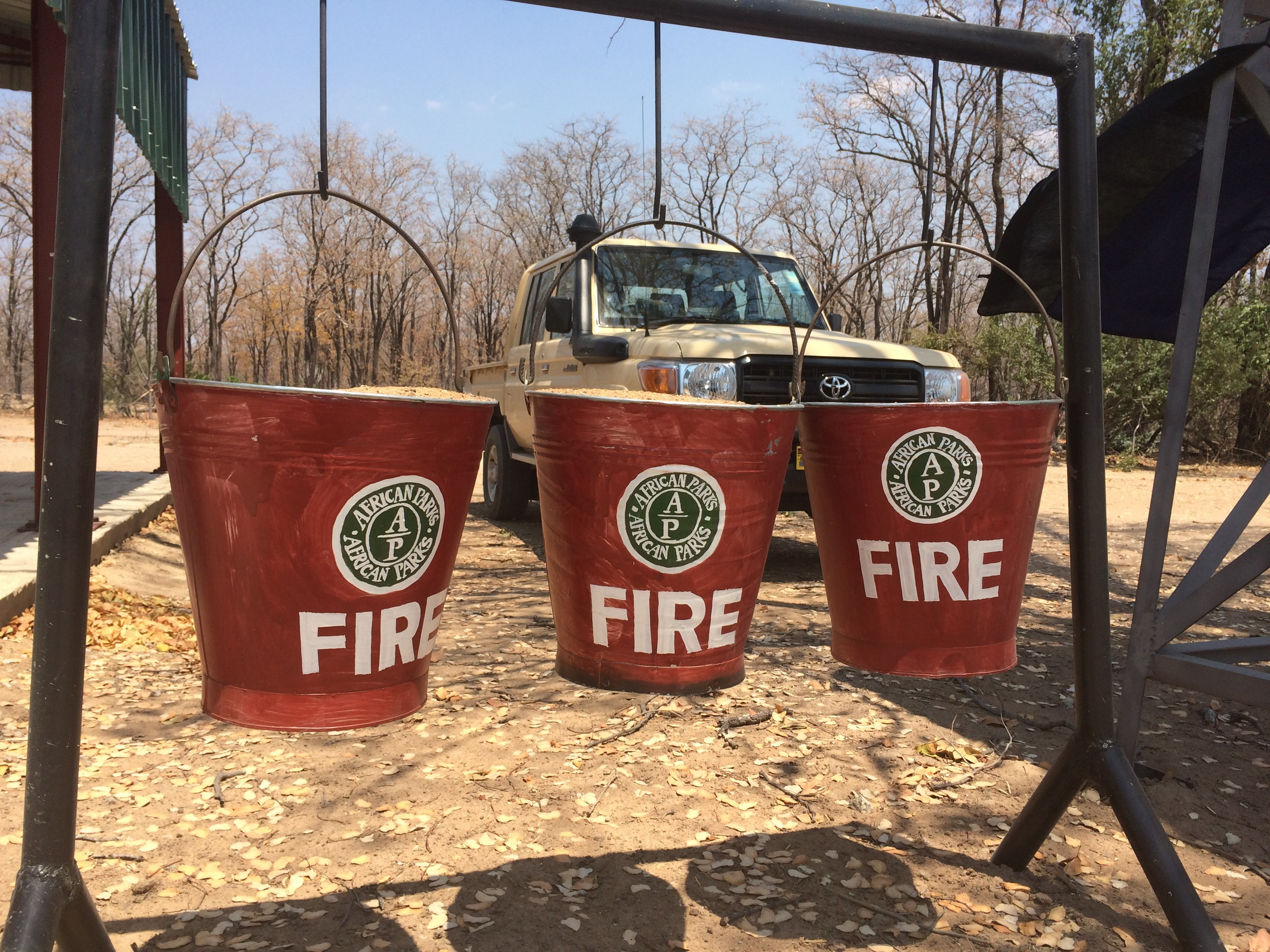 Three buckets hanging with the word, fire on each bucket