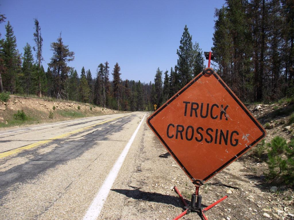 a photo of a sign warning of logging trucks