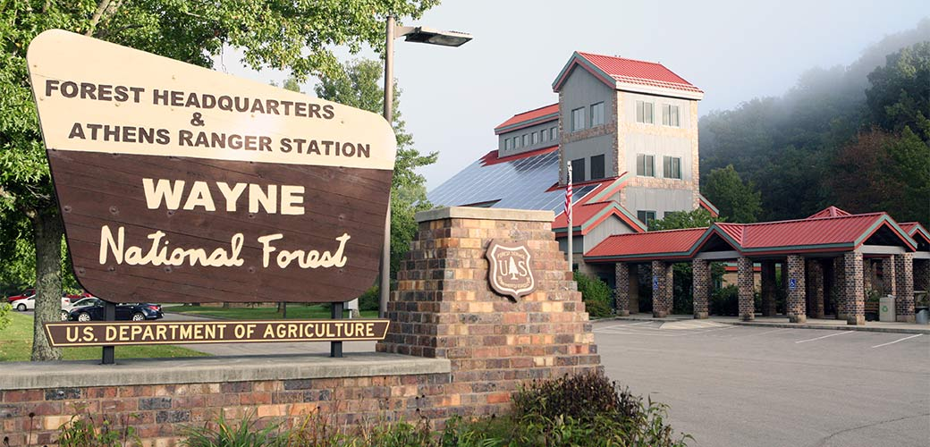 A sign that reads Wayne National Forest Supervisors office and Athens District Ranger Station