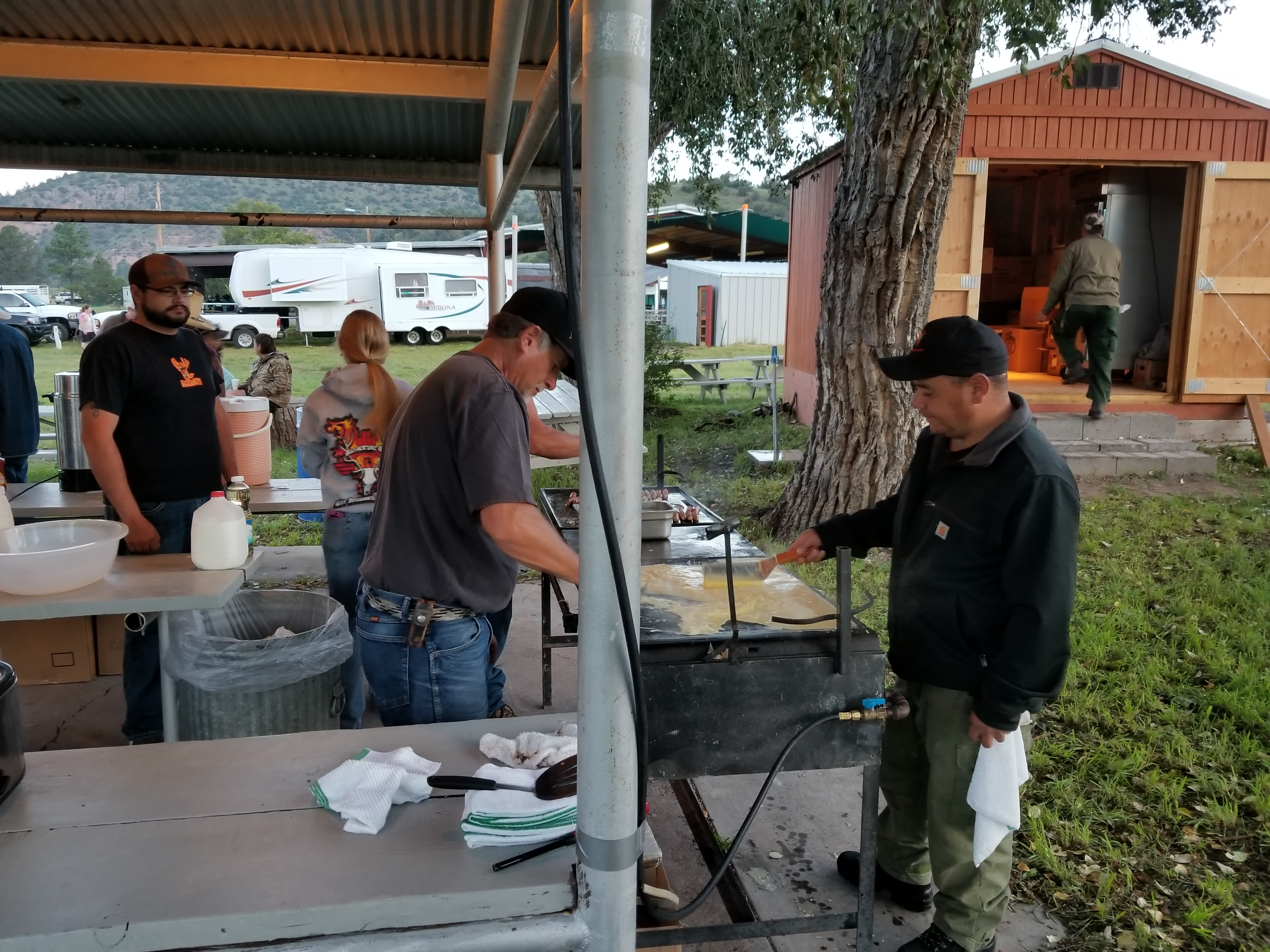 Reserve Ranger District employees serving community members pancakes.