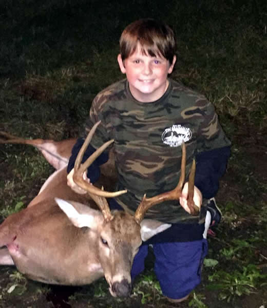 Young boy with deer slain