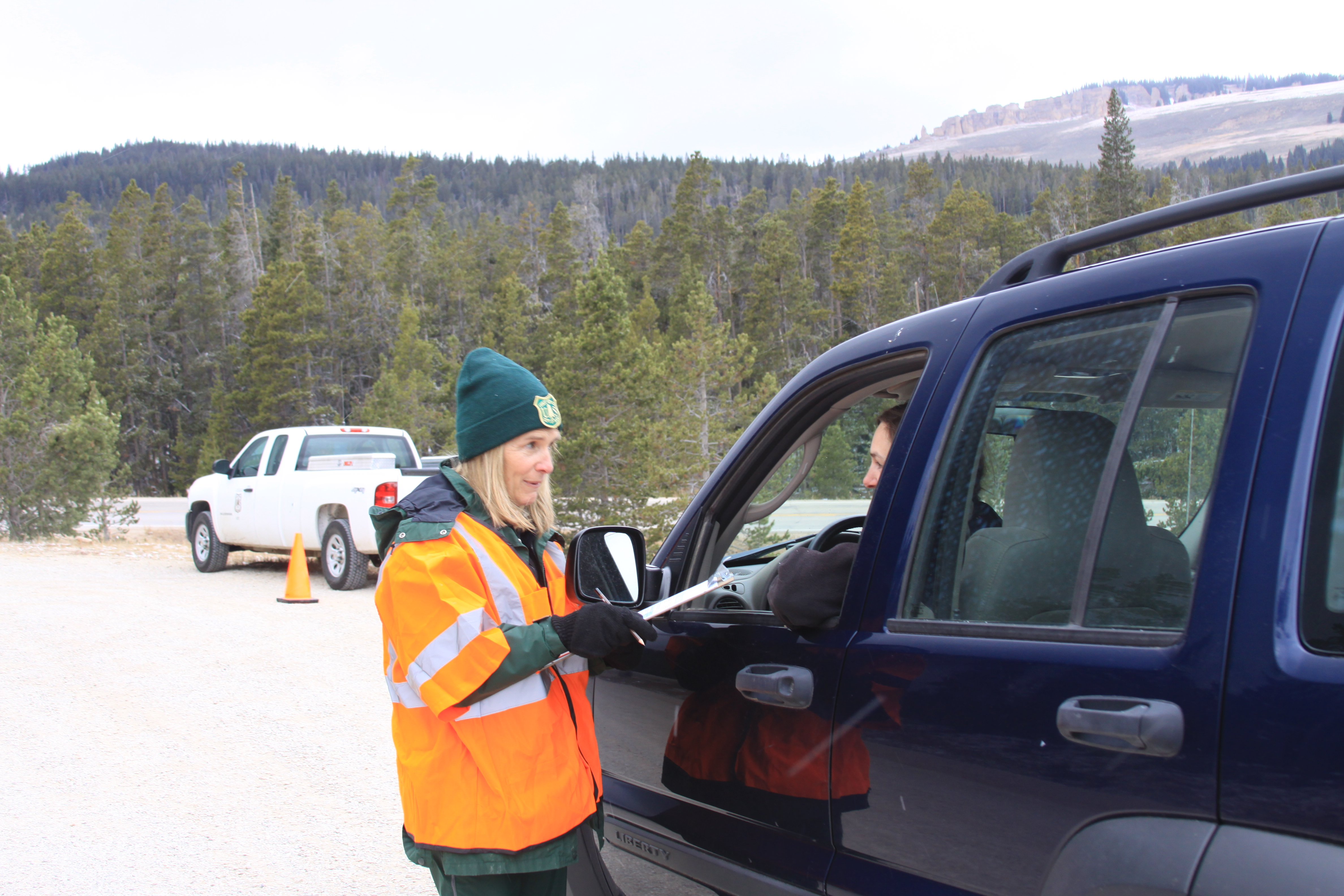 Photo of a Forest Service employee conducting a visitor use survey