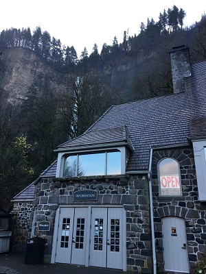 Multnomah Falls Lodge with falls in background on a fall day in Nov. post Eagle Creek Fire