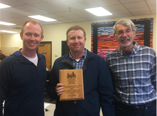 Josh White CNF Three-Rivers District Ranger (center) receives award from Russ Vaagen (left), NEWFC