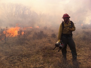 firefighter waits with a radio on the line.