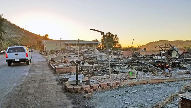 The remains of a home burned during the Lilac Fire.