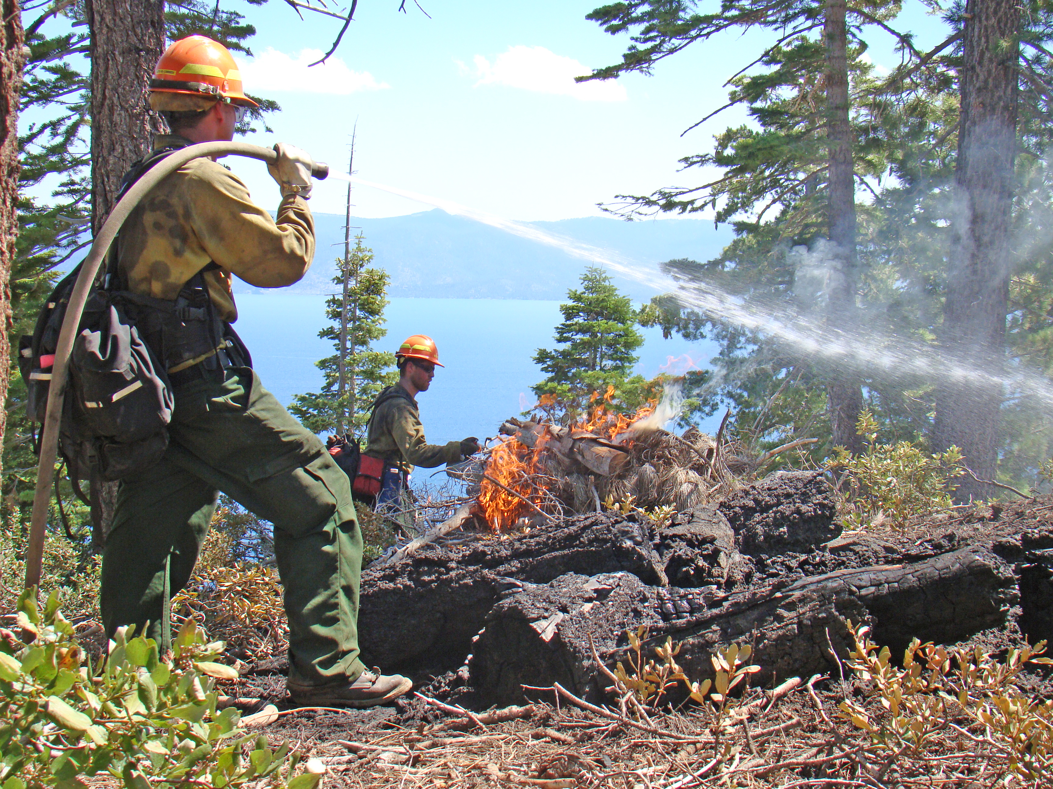 Firefighters conduct prescribed fire operations above Lake Tahoe.