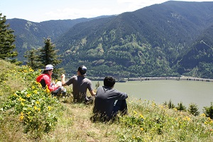 Three hikers enjoy the view from the top of Dog Mountain