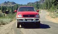 Red Truck on dirt road