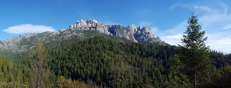The rugged granite peaks of the Castle Crags Wilderness rise above the forested valley below