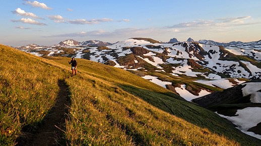 Photo of a person hiking along the Continental Divide Trail.