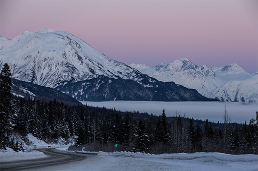 A Motorhome driving down a snowy Seward Highway.