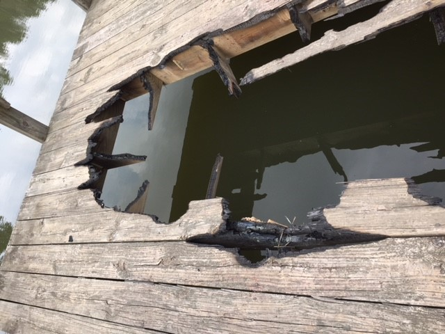 Fishing dock damage by campfire