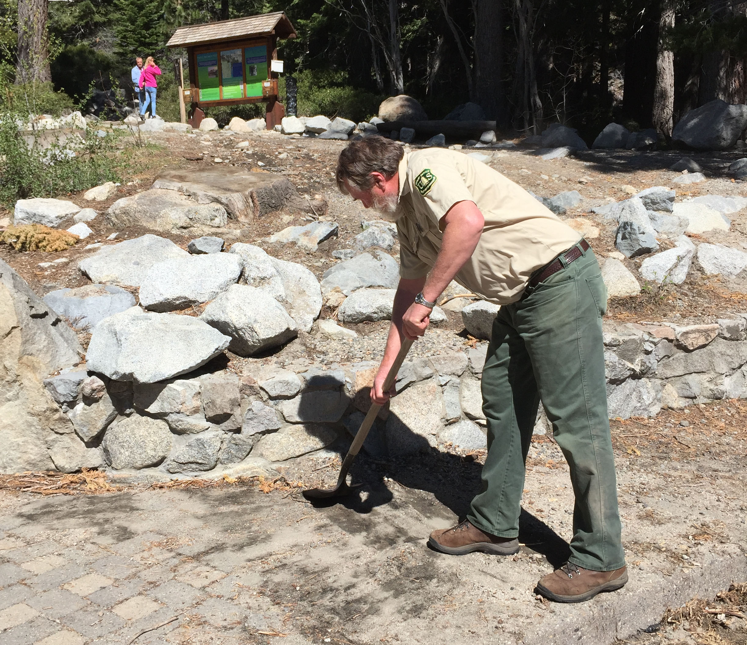 Mike Rhea removes debris from the walkway prior to opening the Eagle Falls Trailhead parking area.