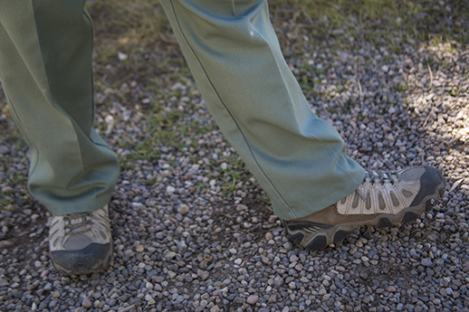 Photo of a brown and tan lace up hiking shoe.