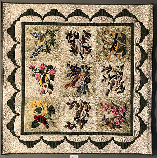 Forget Me Not & Alaska Birds quilt in colors of green, yellow, pink, blues, reds