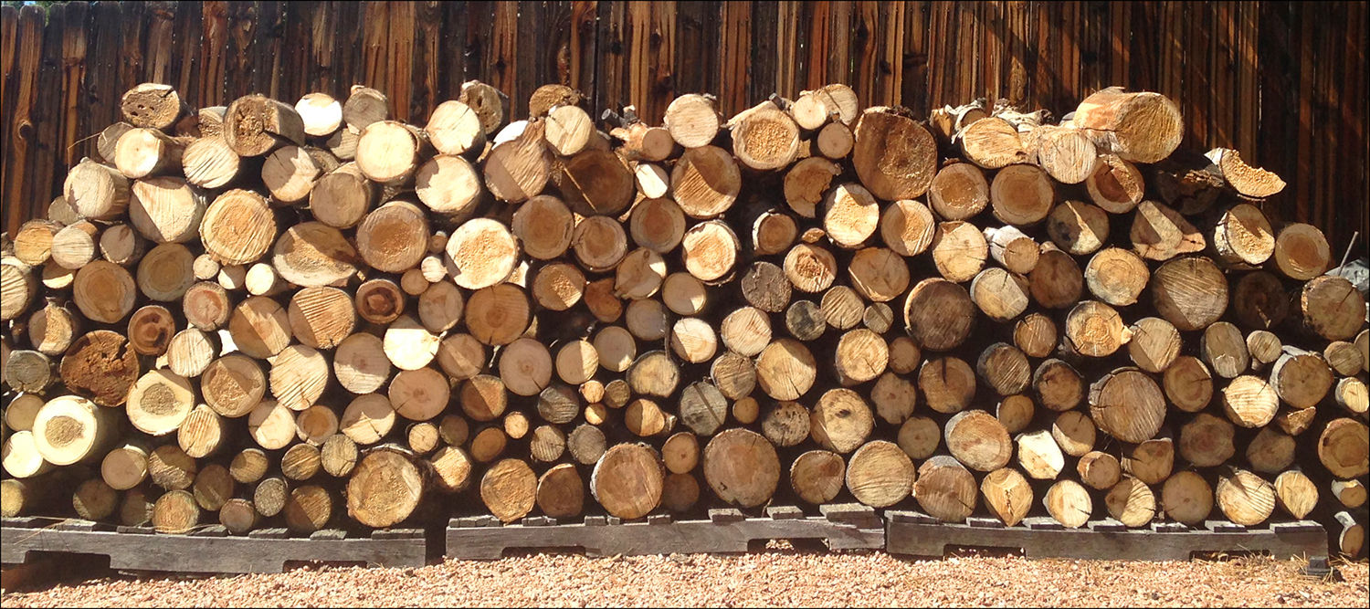 A stacked pile of firewood ready for personal home use