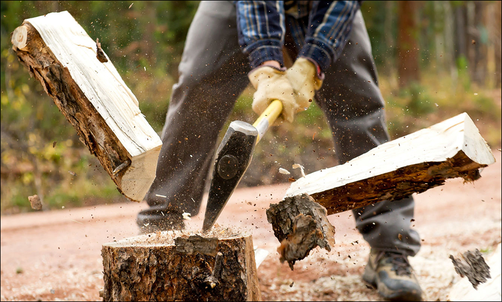 Person chopping wood with ax