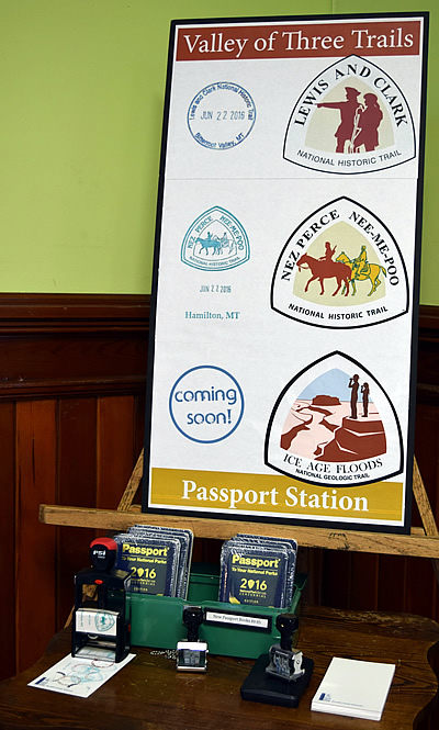 Poster board displaying different passport stamps with stamps below