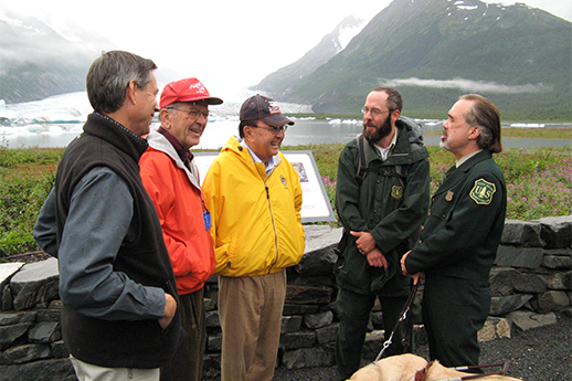Forest Service and Alaska Railroad staff talking to Alaska and Hawaii senators.