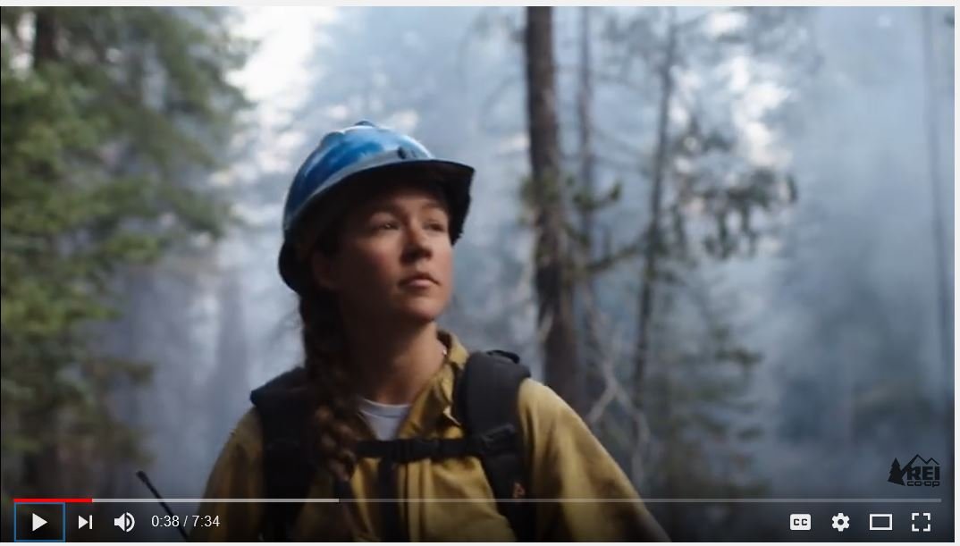 Woman fire fighter in forest.