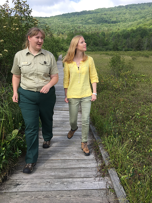 Darly Newman and representatives fo the Forest Service Walk along the Cranberry Glades.
