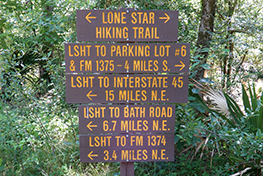 A directional sign on the Lone Star Hiking Trail on the Sam Houston National Forest.