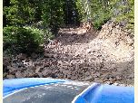 UTV driving through a mud bog on the Battlement Jeep Trail