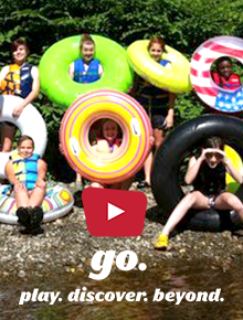 A group of teens pose with tubes along a river. Text says Go Play Discover Beyond.
