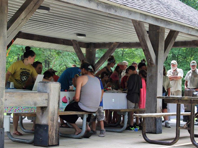 A large group of people occupy a shelter at Hardin ridge.