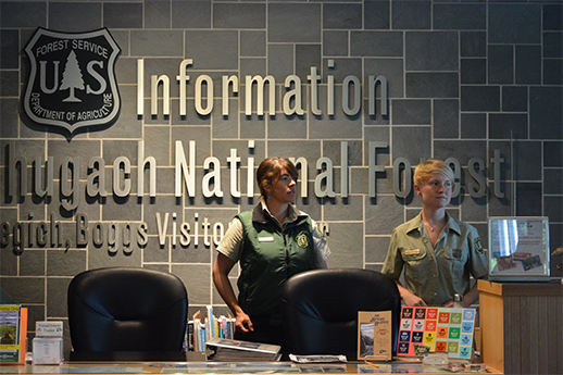 Two Forest Rangers behind the public info desk at BBVC.