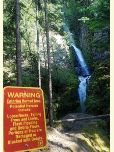 Waterfall at Starvation Creek with warning sign