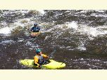 Two kayakers on the Upper Poudre River