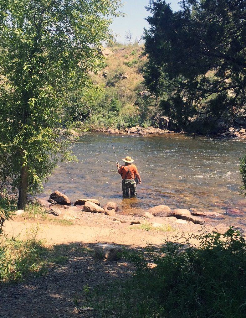 Fisherman in the Upper Poudre River.