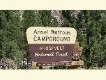 Brown Ansel Watrous campground sign in summer.