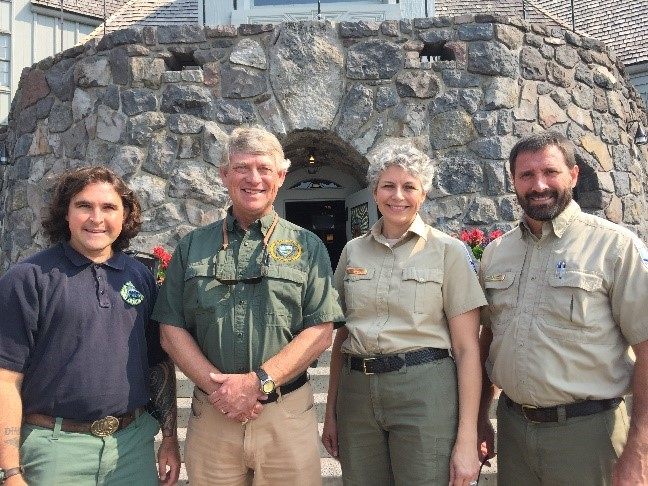 four people standing in front of Timberline Lodge