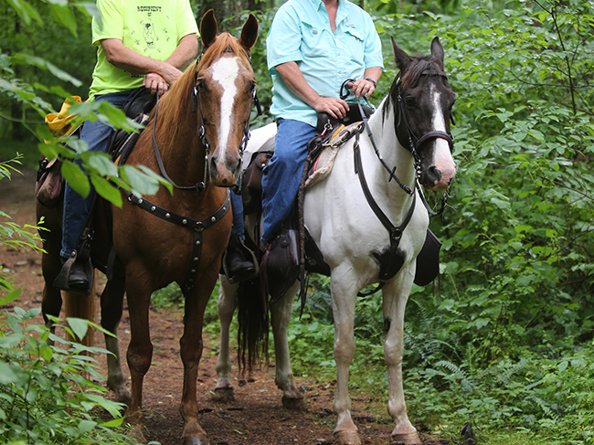 Two men riding Kinderbrook Trail System