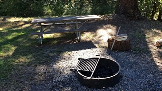 a metal fire ring at a campsite
