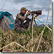 Randy Traynor photographing during his time at Nellie Juan-College Fiord Wilderness.